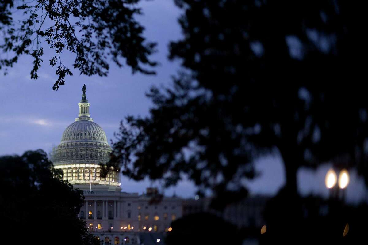 The U.S. Capitol Building in Washington, D.C., on Friday, Oct. 3, 2014. When Congress returns to Washington on Nov. 12, lawmakers' to-do list will include a longer-term government funding measure and legislation setting Defense Department policy. Photographer: Andrew Harrer/Bloomberg