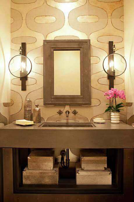 Opt for an open vanity in a small bath to make the room feel more spacious. Photo: Tribune News Service File Photo, McClatchy-Tribune News Service / Charlotte Observer