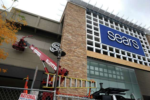 The old sears sign is removed at the Colonie Center on Wednesday Oct. 15, 2014 in Colonie, N.Y.  (Michael P. Farrell/Times Union) Photo: Michael P. Farrell