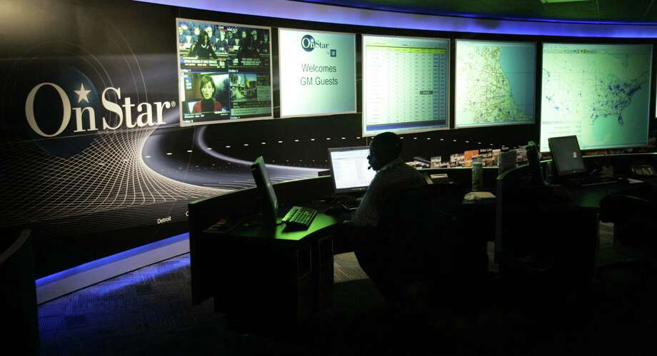 FILE -  The General Motors OnStar command center is shown in Detroit, in this Feb. 6, 2006 file photo. The OnStar automobile communication service maintains its two-way connection with a customer even after the service is discontinued and reserves the right to sell data from that connection. U.S. Sen. Charles Schumer of New York calls that a blatant invasion of privacy and is calling on the Federal Trade Commission to investigate. Schumer is announcing the effort Sunday Sept. 25, 2011 by releasing a letter to the Federal Trade Commission seeking an investigation. (AP Photo/Carlos Osorio) Photo: Associated Press / AP2006