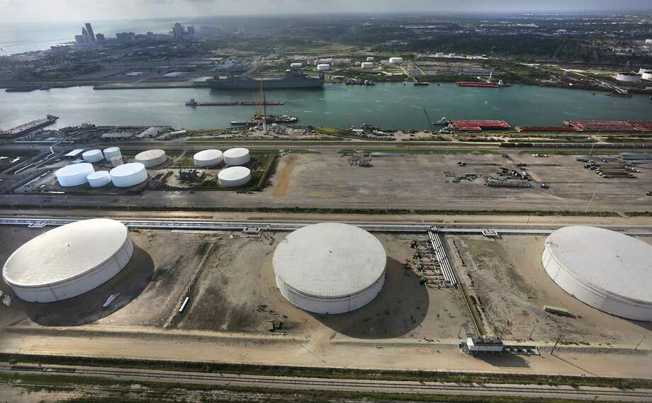 Three of the four crude oil storage tanks that hold 400,000 barrels at NuStar Energy Terminal at the Port Corpus Christi where the Eagle Ford Consortium is meeting through Wednesday. Photo: Bob Owen, Staff / ©2013 San Antonio Express-News