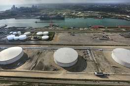 Three of the four crude oil storage tanks that hold 400,000 barrels at NuStar Energy Terminal at the Port Corpus Christi where the Eagle Ford Consortium is meeting through Wednesday.