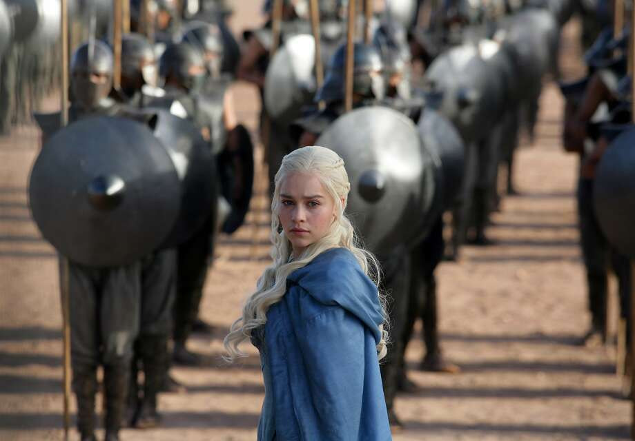 "This file publicity image released by HBO shows Emilia Clarke as Daenerys Targaryen in a scene from ""Game of Thrones.""   HBO plans to offer a stand-alone version of its popular video-streaming service, CEO Richard Plepler said at an investor meeting at parent Time Warner Inc. on Wednesday, Oct. 15, 2014. (AP Photo/HBO, Keith Bernstein, File) Photo: Keith Bernstein, Associated Press"