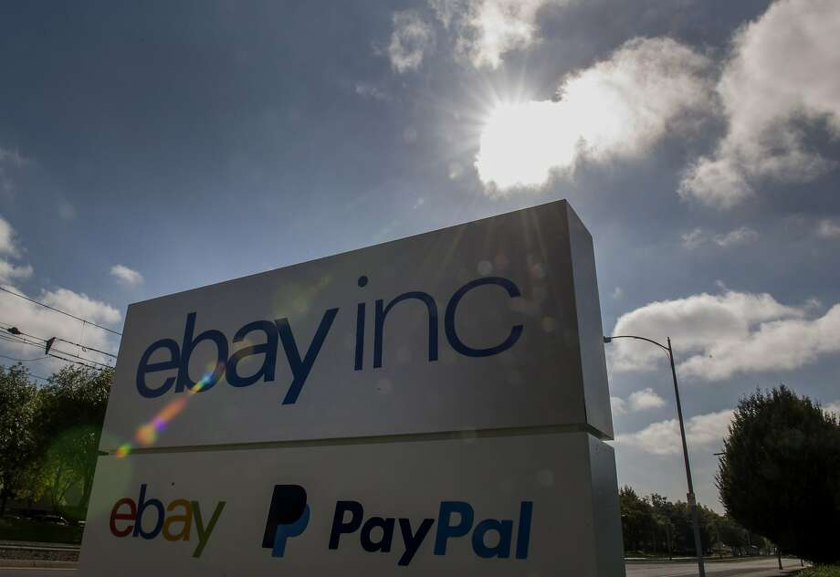 PayPal and eBay Inc. signage is displayed outside of the company's headquarters in San Jose, California, U.S., on Tuesday, Sept. 30, 2014. EBay Inc. is spinning off its PayPal division, heeding demands by activist shareholder Carl Icahn and giving the business independence it can use to contend with rising competition from Apple Inc. and Google Inc. Photographer: David Paul Morris/Bloomberg Photo: David Paul Morris, Bloomberg