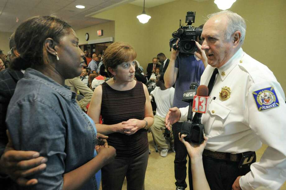 South End resident April Harrison, left, talks with Mayor Kathy Sheehan, center, and Fire Chief Warren W. Abriel, Jr., left, about Ladd 1 during a town hall meeting on the city budget  Wednesday Oct. 15, 2014 in Albany, N.Y.  (Michael P. Farrell/Times Union) Photo: Michael P. Farrell / 00029045A