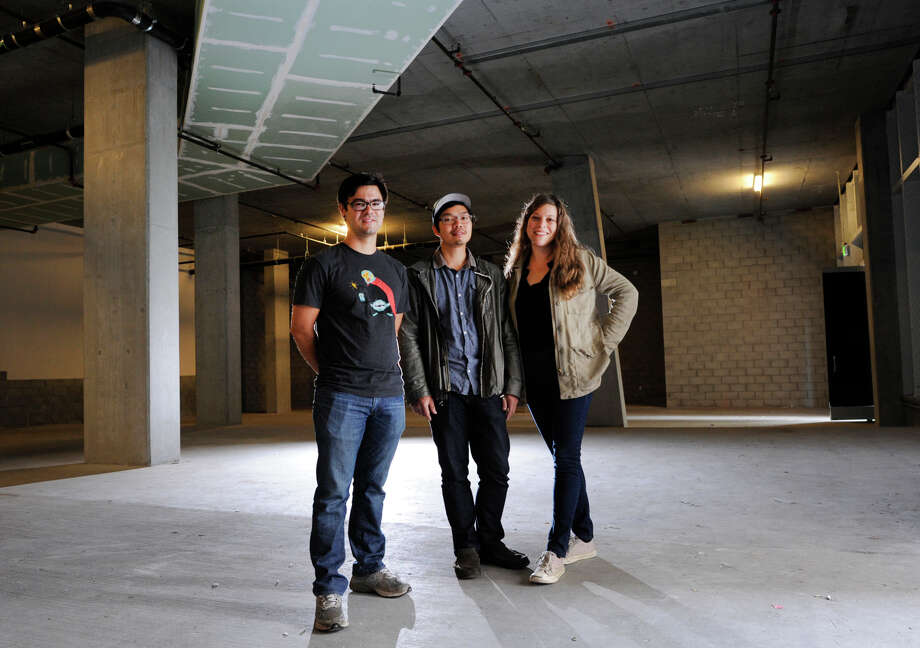 Chef Chris Kiyuna (left) and husband-and-wife restaurateurs Anthony Myint and Karen Leibowitz stand in the space that will become their restaurant, the Perennial, on the ground floor of the AVA building on Ninth Street in San Francisco. Photo: Michael Short / Special To The Chronicle / ONLINE_YES
