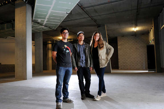 Chef Chris Kiyuna (left) and husband-and-wife restaurateurs Anthony Myint and Karen Leibowitz stand in the space that will become their restaurant, the Perennial, on the ground floor of the AVA building on Ninth Street in San Francisco.