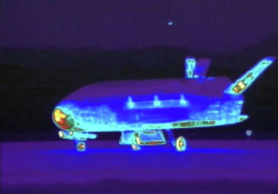 This image from video shows an infrared view of an X-37B unmanned spacecraft landing in 2012 at Vandenberg AFB. The purpose of the craft is classified. Photo: Associated Press / File Photo / Vandenberg Air Force Base