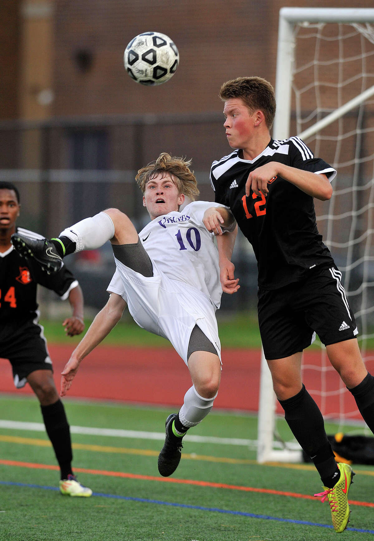 Westhill's Jake Atkinson performs a bicycle kick eventually scoring off a deflection from a Stamford defender while under pressure from Stamford's Kristian Lukasiak during their soccer game at Westhill High School in Stamford, Conn., on Wednesday, Oct. 15, 2014. Westhill won, 3-0.