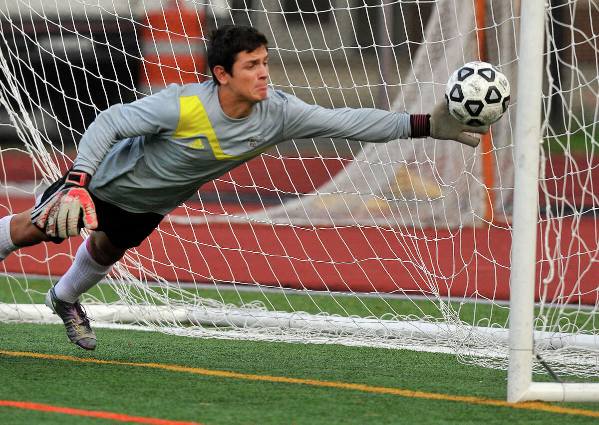 Stamford goalie Andrew Kydes dives unsuccessfully for the ball during the Black Knights' soccer game against Westhill at Westhill High School in Stamford, Conn., on Wednesday, Oct. 15, 2014. Westhill won, 3-0.