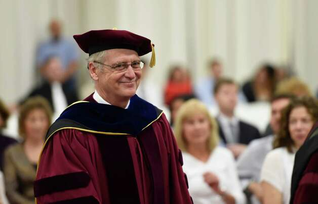 T. Gregory Dewey, Ph.D. walks in to the gym where he will be installed as the 9th president of the Albany College of Pharmacy and Health Sciences during a ceremony held Wednesday morning Oct. 15, 2014 in Albany, N.Y.  (Skip Dickstein/Times Union) Photo: SKIP DICKSTEIN / 10029031A