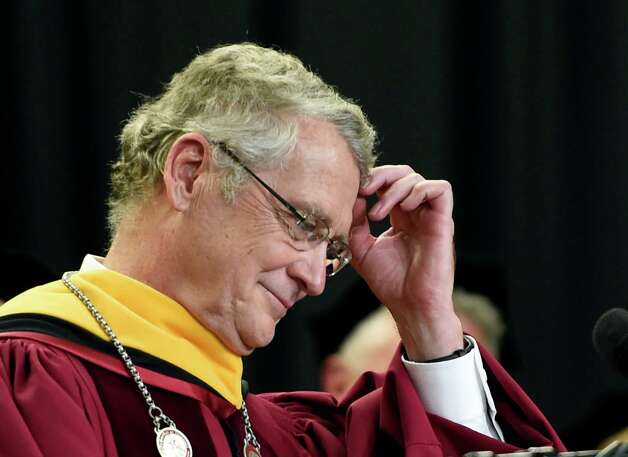 T. Gregory Dewey, Ph.D. scratches his head briefly before giving his presidential address after being installed as the 9th president of the Albany College of Pharmacy and Health Sciences during a ceremony held Wednesday morning Oct. 15, 2014 in Albany, N.Y.  (Skip Dickstein/Times Union) Photo: SKIP DICKSTEIN / 10029031A