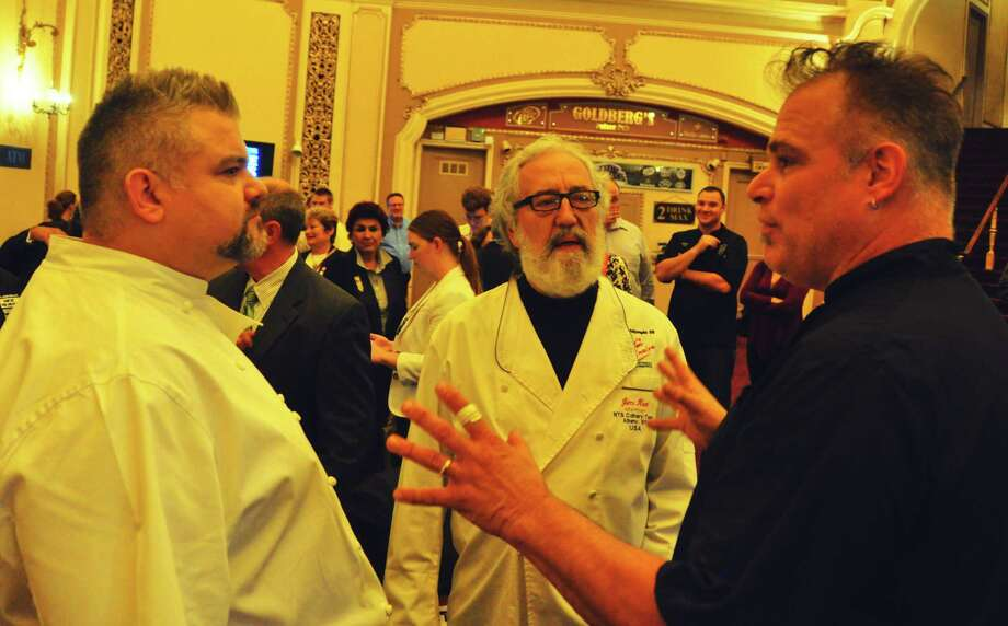 Chefs, from left, Brady Duhame of 15 Church in Saratioga Springs, Jim Rua or Cafe Capriccio and Ric Orlando of New World Bistro Bar, both in Albany, chat during the Wine & Dine for the Arts news conference on Wednesday, Oct. 15, 2014, at the Palace Theatre. (Steve Barnes/Times Union)