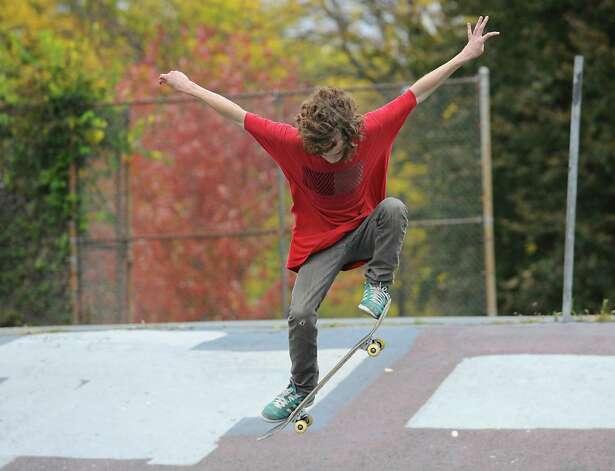 Lee Pryor, 16, of Albany practices tricks on his skateboard in Washington Park on Wednesday, Oct. 15, 2014 in Albany, N.Y. Pryor skates for 5ifth Place, a skateboard shop on Lark St. (Lori Van Buren / Times Union) Photo: Lori Van Buren