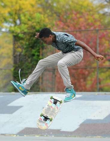 Josiah Sheldon, 15, of Albany enjoys a warm fall day practicing tricks on his skateboard in Washington Park on Wednesday, Oct. 15, 2014 in Albany, N.Y. Pryor skates for 5ifth Place, a skateboard shop on Lark St. (Lori Van Buren / Times Union) Photo: Lori Van Buren