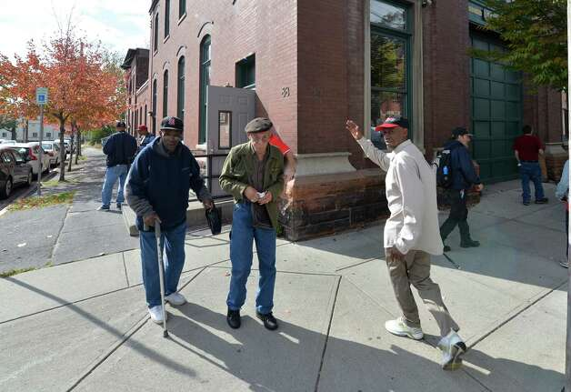 Clients come and go at the St. John's/St. Ann's Outreach soup kitchen in the former Albany Fire Department Engine 5 building Tuesday afternoon Oct. 14, 2014 in Albany, N.Y.  (Skip Dickstein/Times Union) Photo: SKIP DICKSTEIN / 10029007A