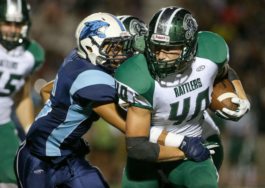 Reagan's Brucks Saathoff (right) enters Friday's contest against Churchill with three interceptions, including this one against Johnson. Photo: Marvin Pfeiffer / San Antonio Express-News / Express-News 2014