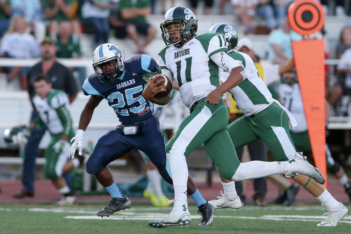 Reagan quarterback Kellen Mond finds running room during the first quarter of their game with Johnson at Comalander Stadium on Saturday, Oct. 4, 2014. MARVIN PFEIFFER/ mpfeiffer@express-news.net