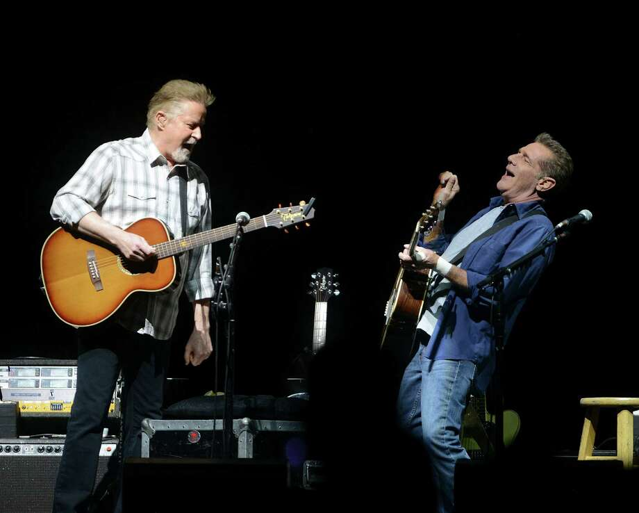 "Don Henley, left, and Glenn Frey of the Eagles have a laugh onstage during their ""The History of the Eagles"" tour stop at the AT&T Center on Wednesday, Oct. 15, 2014. Photo: Billy Calzada"