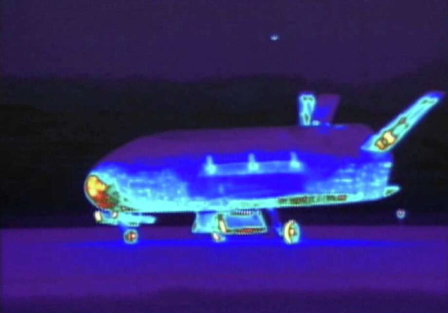 This June 16, 2012 file image from video made available by the Vandenberg Air Force Base shows an infrared view of the X-37B unmanned spacecraft landing at Vandenberg Air Force Base.  The purpose of the U.S. military's space plane is classified, only fueling speculation about why it has been orbiting Earth for nearly two years on this, its third mission. The plane is expected to land this week at a Southern California Air Force base.(AP Photo/Vandenberg Air Force Base, File) ORG XMIT: LA102 / Vandenberg Air Force Base