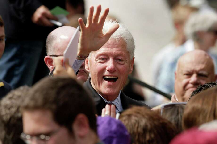 """In this photo taken Oct. 6, 2014, former President Bill Clinton greets supporters after a political rally at the University of Central Arkansas in Conway, Ark. Democrats claimed a triumph after Clinton recently campaigned in Arkansas, announcing they had signed up enough partisans to fill 4,000 volunteer shifts through Election Day. Now the concern is the """"flake rate"""" _ the number who fail to show up. Welcome to the final stages of a costly voter turnout operation in Arkansas and other states, which loom as the Democrats' last line of defense in their effort to keep control of the Senate. (AP Photo/Danny Johnston) ORG XMIT: WX201 Photo: Danny Johnston / AP"""