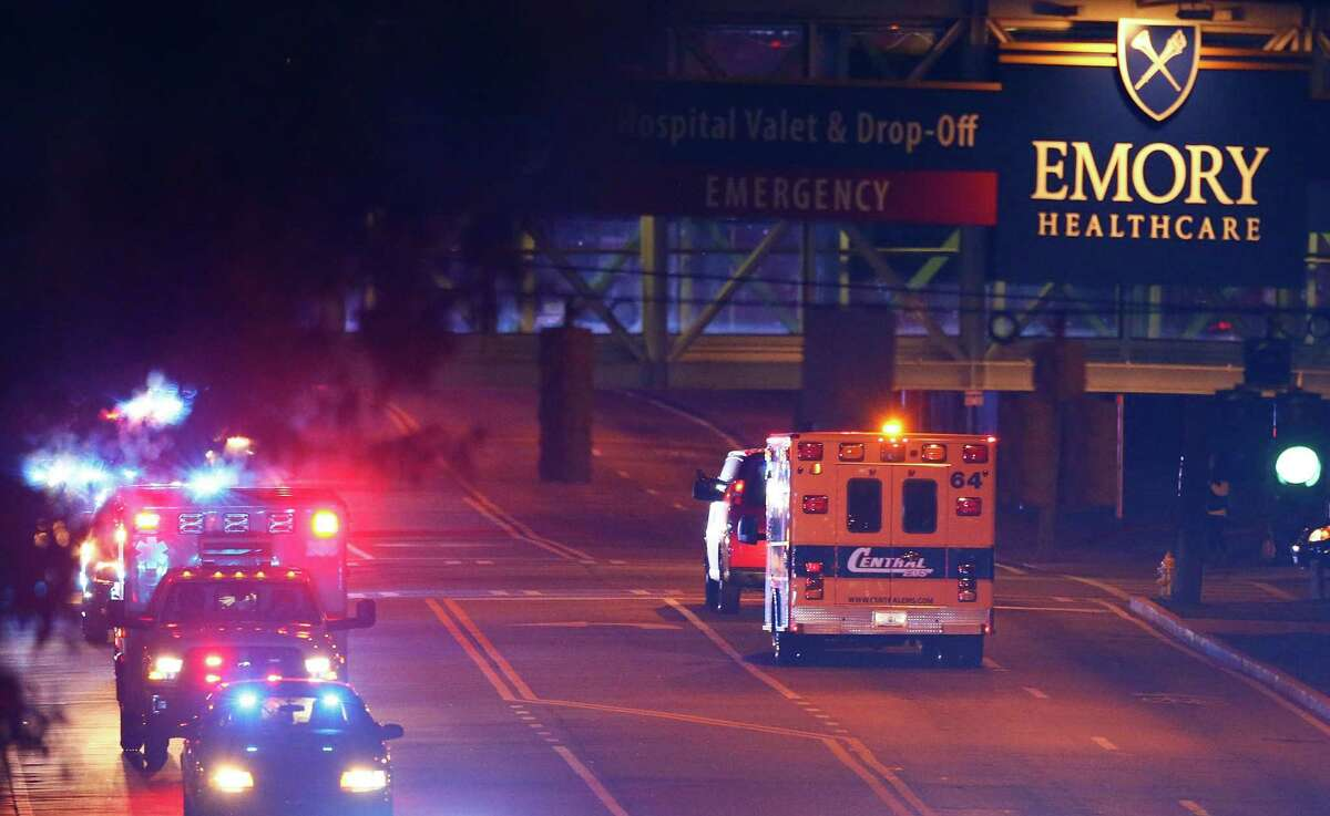 Ebola patient Amber Vinson arrives by ambulance at Emory University Hospital in Atlanta. Nurse Vinson joins Nina Pham as health workers who have contracted the Ebola virus at Texas Heath Presbyterian Hospital while treating patient Thomas Eric Duncan, who has since died.