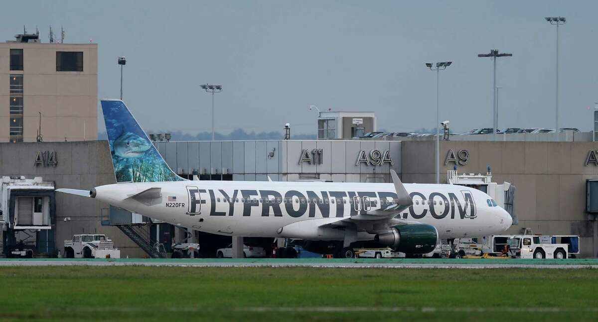 The Frontier Airlines plane that Amber Vinson flew from Cleveland to Dallas on Monday leaves the terminal at Cleveland Hopkins International Airport.