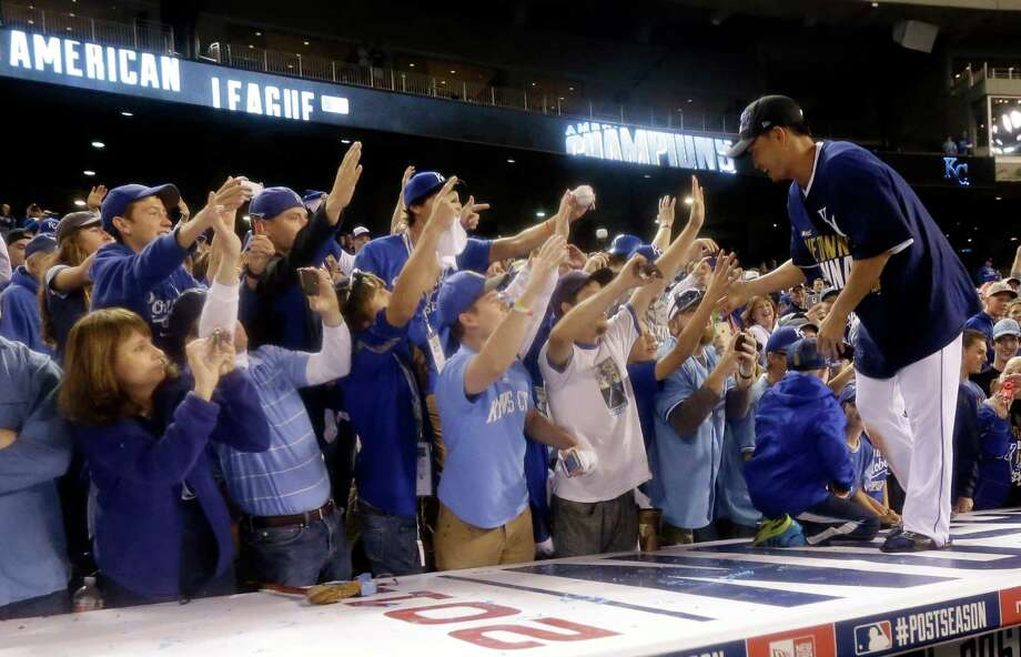 Kansas City Royals' Norichika Aoki celebrates with fans after the Royals defeated the Baltimore Orioles 2-1 in Game 4 of the American League baseball championship series Wednesday, Oct. 15, 2014, in Kansas City, Mo. The Royals advance to the World Series. (AP Photo/Charlie Riedel)  ORG XMIT: ALCS274 Photo: Charlie Riedel / AP