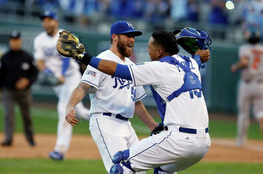 Kansas City Royals relief pitcher Greg Holland and catcher Salvador Perez celebrate after defeating against the Baltimore Orioles 2-1 in Game 4 of the American League baseball championship series Wednesday, Oct. 15, 2014, in Kansas City, Mo. The Royals advance to the World Series. (AP Photo/Orlin Wagner)  ORG XMIT: ALCS216 Photo: Orlin Wagner / AP