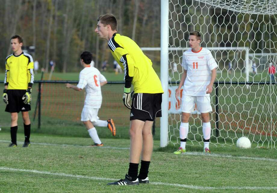 Bethlehem twin brothers Liam Dole, center,goalie and Luke Dole, right, warm up before their soccer game against Averill Park on Thursday Oct. 9, 2014 in Delmar, N.Y.  (Michael P. Farrell/Times Union) Photo: Michael P. Farrell / 10028949A