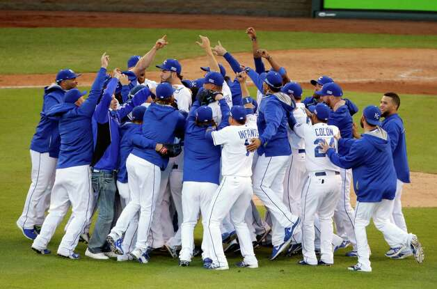 The Kansas City Royals players celebrate after the Royals defeated the Baltimore Orioles 2-1 in Game 4 of the American League baseball championship series Wednesday, Oct. 15, 2014, in Kansas City, Mo. The Royals advance to the World Series. (AP Photo/Michael Conroy)  ORG XMIT: ALCS225 Photo: Michael Conroy / AP