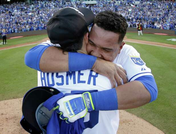 Kansas City Royals' Salvador Perez and Eric Hosmer celebrate after the Royals defeated the Baltimore Orioles 2-1 in Game 4 of the American League baseball championship series Wednesday, Oct. 15, 2014, in Kansas City, Mo. The Royals advance to the World Series. (AP Photo/Charlie Riedel)  ORG XMIT: ALCS229 Photo: Charlie Riedel / AP
