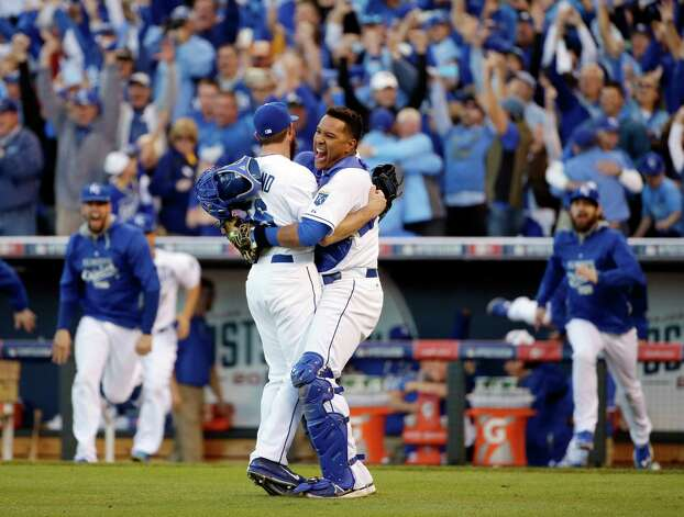 Kansas City Royals relief pitcher Greg Holland and catcher Salvador Perez celebrate after the Royals defeated the Baltimore Orioles 2-1 in Game 4 of the American League baseball championship series Wednesday, Oct. 15, 2014, in Kansas City, Mo. The Royals advance to the World Series. (AP Photo/Matt Slocum )  ORG XMIT: ALCS234 Photo: Matt Slocum / AP