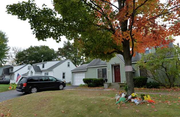 A forensics van sits outside the murder scene Wednesday afternoon Oct. 15, 2014 in Guilderland, N.Y.   (Skip Dickstein/Times Union) Photo: SKIP DICKSTEIN