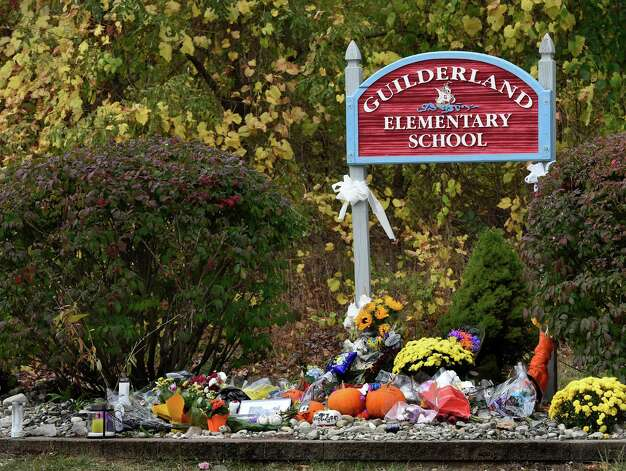 A large memorial has been set up at the base of the Guilderland Elementary School sign Wednesday afternoon Oct. 15, 2014 in Guilderland, N.Y.  Guilderland Elementary School is where the two deceased children went to school preceding their murder.   (Skip Dickstein/Times Union) Photo: SKIP DICKSTEIN