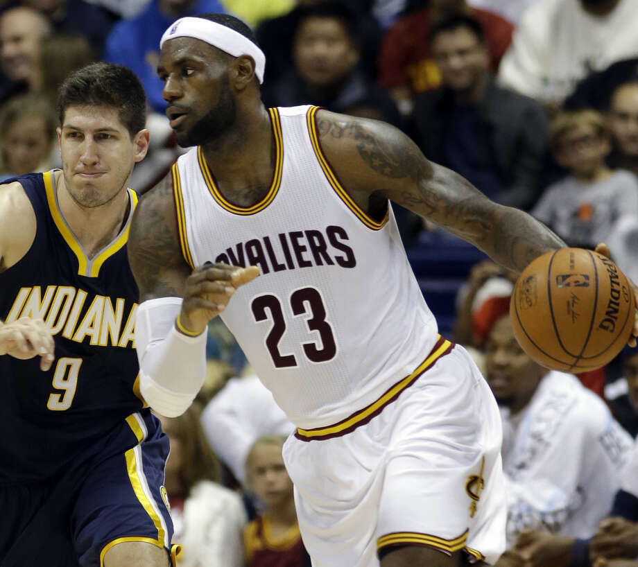 Cleveland's LeBron James (26 points) drives against Indiana's Damjan Rudez during the first half of their exhibition game. Photo: Al Behrman / Associated Press / AP