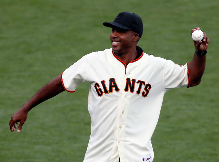 File - In this 2014, file photo, career home run leader Barry Bonds is seen throwing out the first pitch in an NLCS game. Bonds' obstruction of justice conviction reversed by 9th US Circuit Court of Appeals on Wednesday, April 22, 2015. (AP Photo/Eric Risberg, File) Photo: Beck Diefenbach, Staff Photo / ONLINE_YES
