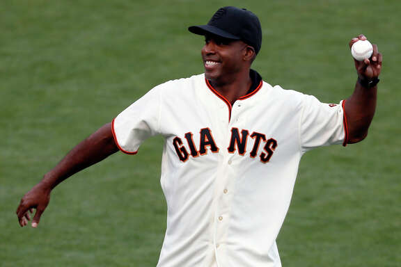 Former Giants player Barry Bonds throws the ceremonial first pitch during Game 4 of the NLCS at AT&T Park on Wednesday, Oct. 15, 2014 in San Francisco, Calif.