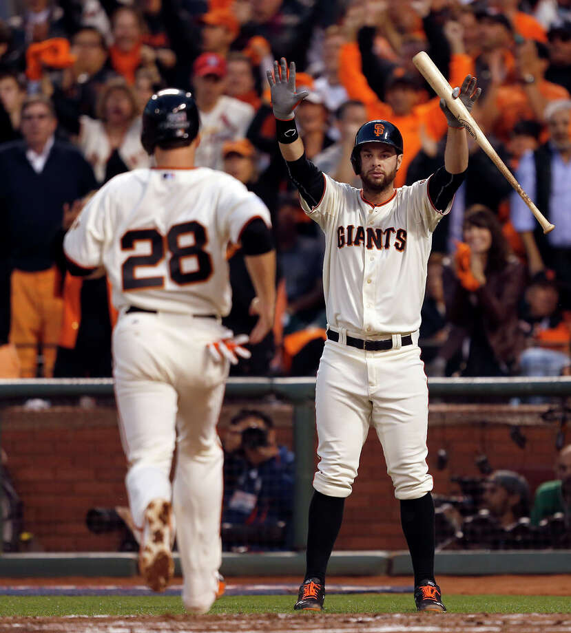 Giants Brandon Belt celebrates a Buster Posey score off of a Hunter Pence single in the third inning during Game 4 of the NLCS at AT&T Park on Wednesday, Oct. 15, 2014 in San Francisco, Calif. Photo: Scott Strazzante, Staff Photo / ONLINE_YES