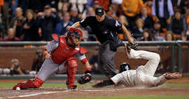 Giants Juan Perez scores in the sixth inning during Game 4 of the NLCS at AT&T Park on Wednesday, Oct. 15, 2014 in San Francisco, Calif.