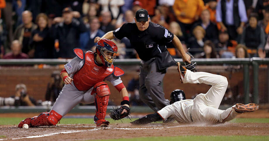 Giants Juan Perez scores in the sixth inning during Game 4 of the NLCS at AT&T Park on Wednesday, Oct. 15, 2014 in San Francisco, Calif. Photo: Scott Strazzante, Staff Photo / ONLINE_YES