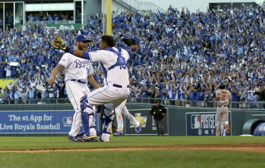 Royals fans go crazy as closer Greg Holland and catcher Salvador Perez rejoice after Kansas City clinched an ALCS sweep of Baltimore that sent the franchise to the World Series for the first time in 29 years. Photo: Charlie Riedel / Associated Press / AP