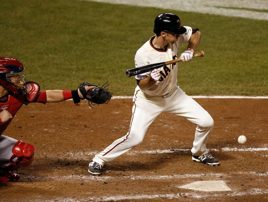 Matt Duffy lays down a sacrifice bunt in the sixth inning during Game 4 of the NLCS at AT&T Park on Wednesday, Oct. 15, 2014 in San Francisco, Calif. Photo: Beck Diefenbach, Special To The Chronicle