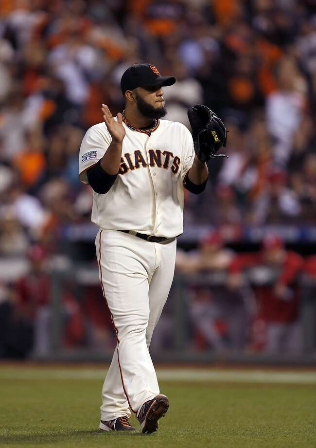 Giants Yusmeiro Petit walks to the dugout after retiring the side in the fourth inning during Game 4 of the NLCS at AT&T Park on Wednesday, Oct. 15, 2014 in San Francisco, Calif. Photo: Scott Strazzante, The Chronicle