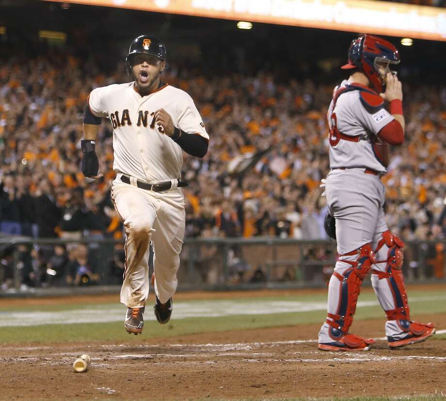 Giants Gregor Blanco scores in the sixth inning on an RBI single by Buster Posey during Game 4 of the NLCS at AT&T Park on Wednesday, Oct. 15, 2014 in San Francisco, Calif. Photo: Michael Macor, The Chronicle