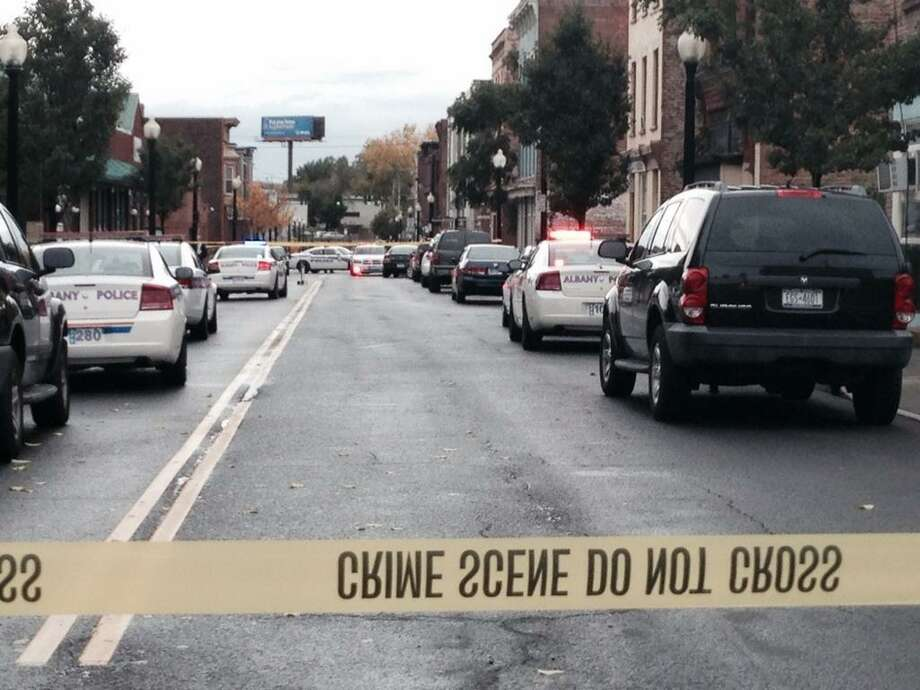 Albany police closed the 300 block of South Pearl Street after at least one man was shot and sent to the hospital. (Lori Van Buren / Times Union)