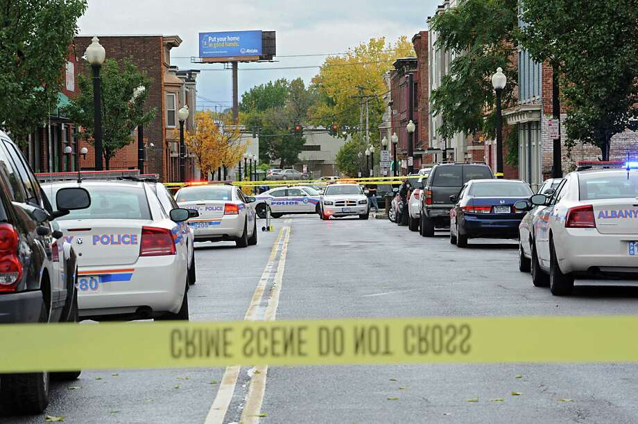Police investigate a shooting of a male victim in the 300 block of South Pearl St. on Thursday, Oct. 16, 2014 in Albany, N.Y.  (Lori Van Buren / Times Union) Photo: Lori Van Buren
