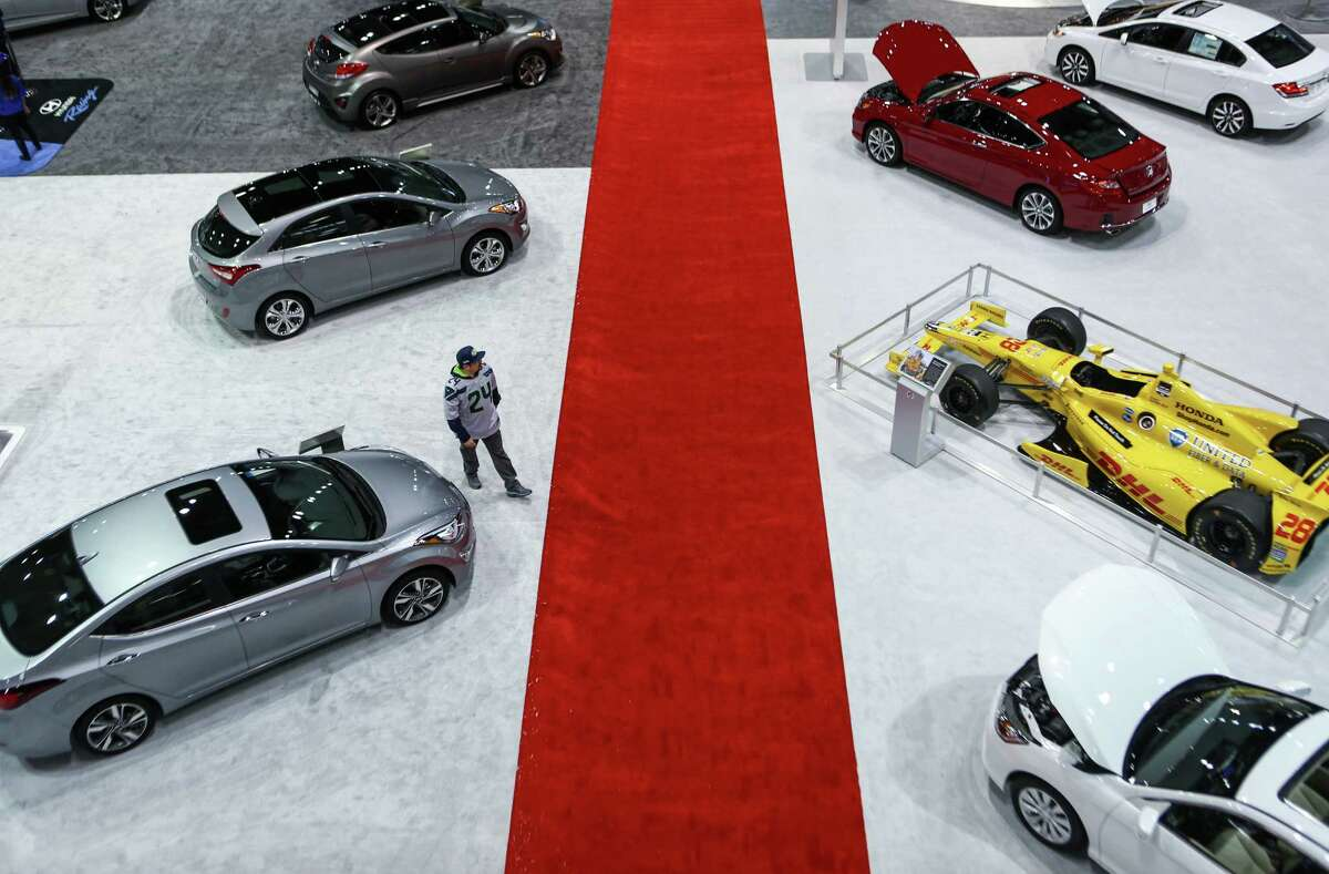 Cars, including Hyuandi and Honda models, are shown during the Seattle Auto Show at CenturyLink Field Events Center. The Seattle Auto Show continues through October 19th. Photographed on Wednesday, October 15, 2014.
