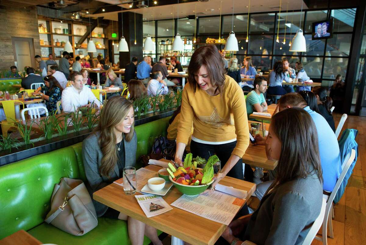 Blair Crabtree, center, serves a Vegetable Crudité, to Eva Wolod, left, and Lauren page, right, at True Food Kitchen, Wednesday, Oct. 15, 2014, in Houston. (Cody Duty / Houston Chronicle)