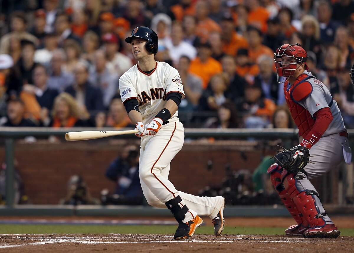 Giants Buster Posey gets an RBI single in the third inning during Game 4 of the NLCS at AT&T Park on Wednesday, Oct. 15, 2014 in San Francisco, Calif.